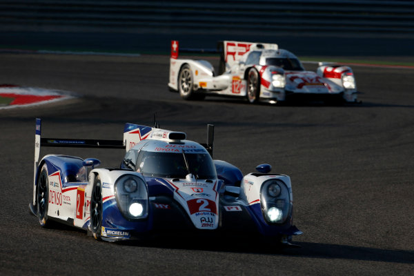 2015 FIA World Endurance Championship Bahrain 6-Hours Bahrain International Circuit, Bahrain Saturday 21 November 2015. Alexander Wurz, St?phane Sarrazin, Mike Conway (#2 LMP1 Toyota Racing Toyota TS 040 Hybrid) leads Nicolas Prost, Mathias Beche, Nick Heidfeld (#12 LMP1 Rebellion Racing Rebellion R-One AER). World Copyright: Alastair Staley/LAT Photographic ref: Digital Image _79P0140
