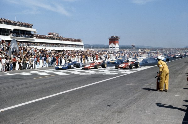 1971 French Grand Prix.Paul Ricard, France. 4 July 1971.Jackie Stewart, Tyrrell 003-Ford, 1st position, Clay Regazzoni, Ferrari 312B2, retired, and Jacky Ickx, Ferrari 312B2, retired, on the front row, action.World Copyright: LAT PhotographicRef: 35mm transparency 71FRA14