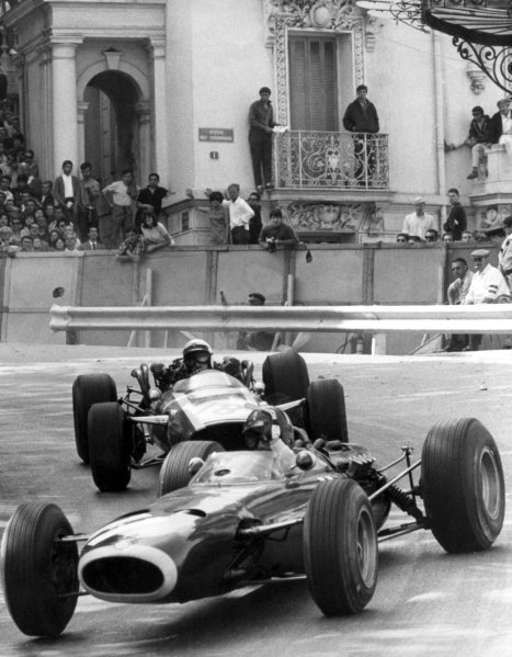 1966 Monaco Grand Prix.Monte Carlo, Monaco. 22 May 1966.Graham Hill, BRM P261, 3rd position, leads Jo Bonnier, Cooper T81-Maserati, not classified, at the finish, action.World Copyright: LAT PhotographicRef: Autosport b&w print