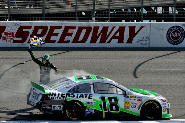 22-24 March 2013, Fontana, California USA Kyle Busch, Interstate Batteries Toyota Camry, celebrate the win with the checkered flag ©2013, Scott R LePage LAT Photo USA