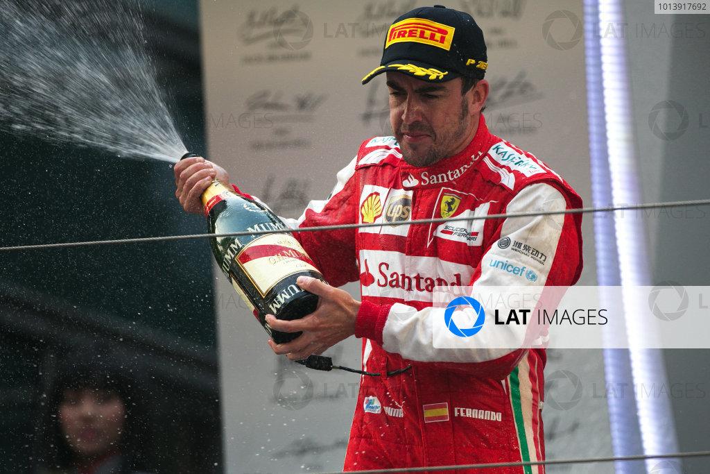 Shanghai International Circuit, Shanghai, China Sunday 14th April 2013 Fernando Alonso, Ferrari, 1st position, celebrates on the podium with Champagne. World Copyright: Andy Hone/LAT Photographic ref: Digital Image HONZ7932