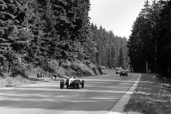 1960 Belgian Grand Prix.Spa-Francorchamps, Belgium. 19 June 1960.Jack Brabham, Cooper T53-Climax, 1st position, follows a group of cars, action.World Copyright: LAT PhotographicRef: Autosport b&w print. Published: Autosport, 24/6/1960 p864