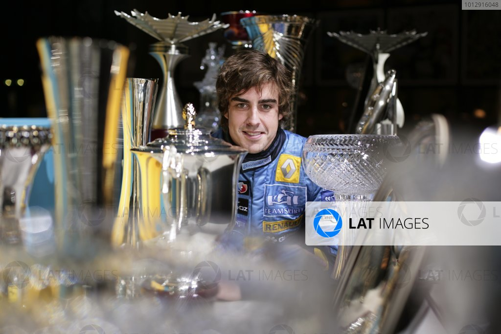 2005 Fernando Alonso - World Champion Fernando Alonso, the 2005 Formula One World Drivers Champion, is photographed amonmgst all his trophies from the 2005 season. Photo: Steven Tee/Renault F1 ref: VY9E3871