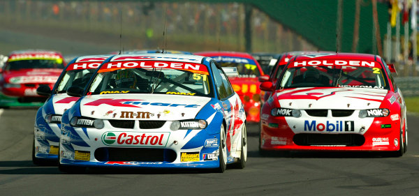 2002 V8 Supercar Championship Round 12 Pukekohe New Zealand 10/11/02: Kmart Racing driver Greg Murphy leads the field at the start of race 3. Murphy went on to win back to back in New Zealand.World Copyright - Horsburgh / LAT Photographicref: digital file only