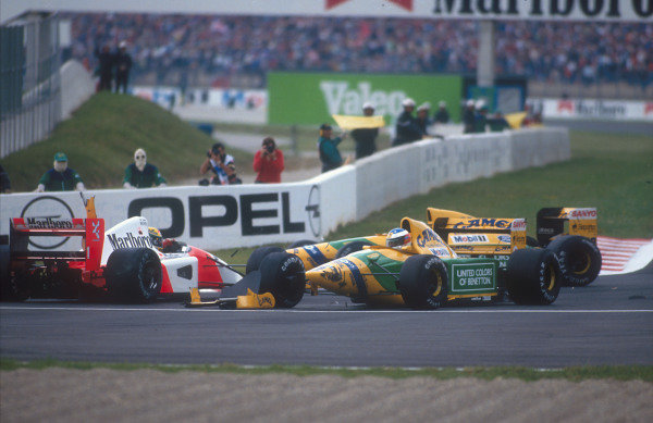 1992 French Grand Prix.Magny-Cours, France.3-5 June 1992.Ayrton Senna (McLaren MP4/7A Honda) is taken out by Michael Schumacher (Benetton B192 Ford) at the Adelaide Hairpin on the first lap.Ref-92 FRA 01.World Copyright - LAT Photographic