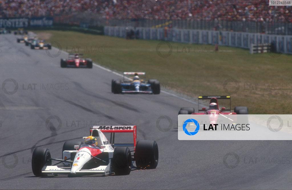 1991 German Grand Prix.Hockenheim, Germany.26-28 July 1991.Ayrton Senna (McLaren MP4/6 Honda) at the Nordkurve, followed by Alain Prost (Ferrari 643), Riccardo Patrese (Williams FW14 Renault) and Jean Alesi (Ferrari 643).Ref-91 GER 03.World Copyright - LAT Photographic