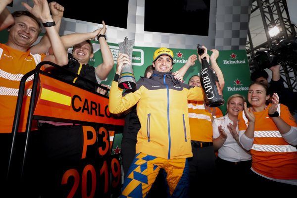 Carlos Sainz Jr, McLaren celebrates his third position on the podium with the McLaren team