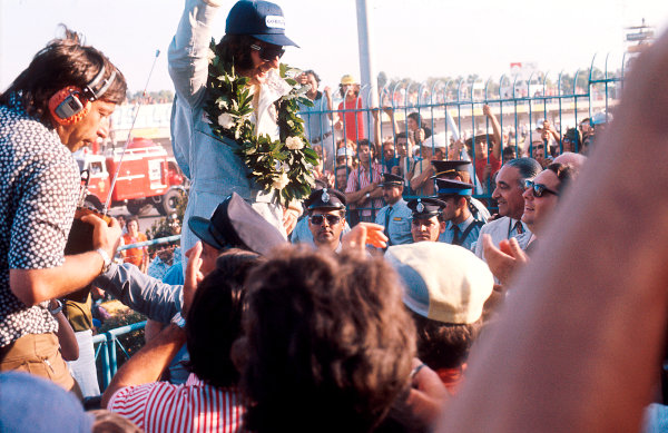 1973 Argentinian Grand Prix.Buenos Aires, Argentina.26-28 January 1973.Emerson Fittipaldi (Team Lotus) 1st position on the podium.Ref-73 ARG 11.World Copyright - LAT Photographic