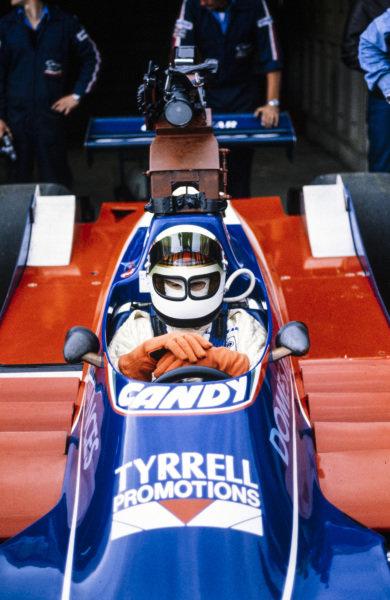Jackie Stewart prepares to do a demonstration run in Jean-Pierre Jarier's Tyrrell 010 Ford.