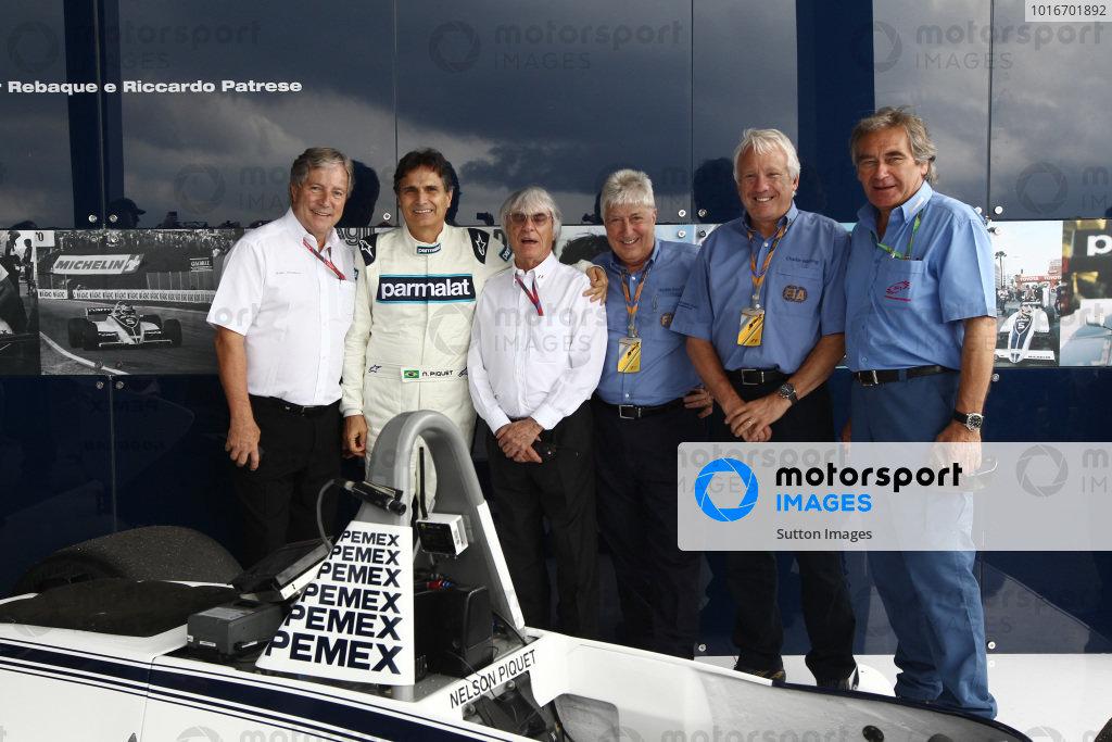Alan Woollard (GBR), Nelson Piquet (BRA), Bernie Ecclestone (GBR) CEO Formula One Group (FOM), Herbie Blash (GBR) FIA Delegate, Charlie Whiting (GBR) FIA Delegate  with the Brabham BT49C.  Formula One World Championship, Rd 19, Brazilian Grand Prix, Race, Interlagos, Sao Paulo, Brazil, Sunday 27 November 2011.   BEST IMAGE