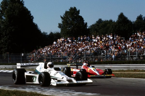 (L to R): Thirteenth placed Alan Jones (AUS) Williams FW06 is passed by Gilles Villeneuve (CDN) Ferrari 312T3, who finished second on the road but was classified seventh after being penalised a minute for jumping the start.