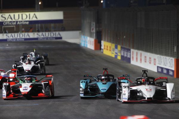 Pascal Wehrlein (DEU) Tag Heuer Porsche, Porsche 99X Electric, leads Mitch Evans (NZL) Panasonic Jaguar Racing, Jaguar I-Type 5, and Rene Rast (DEU) Audi Sport ABT Schaeffler, Audi e-tron FE07