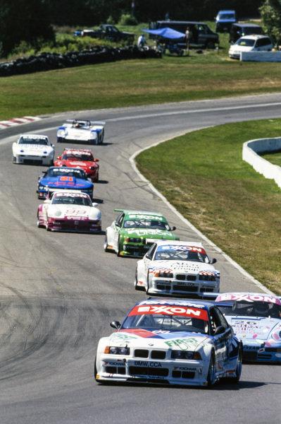 Javier Quiros / Boris Said / Pete Halsmer / Bill Auberlen, Prototype Technology Group, BMW M3 E36, leads Hurley Haywood / Tom Hessert, Alex Job Racing, Porsche 911 ME.