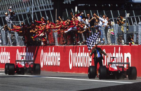 Rubens Barrichello, Ferrari F2002, leads Michael Schumacher, Ferrari F2002, home for a Ferrari 1-2 to the delight of the team.
