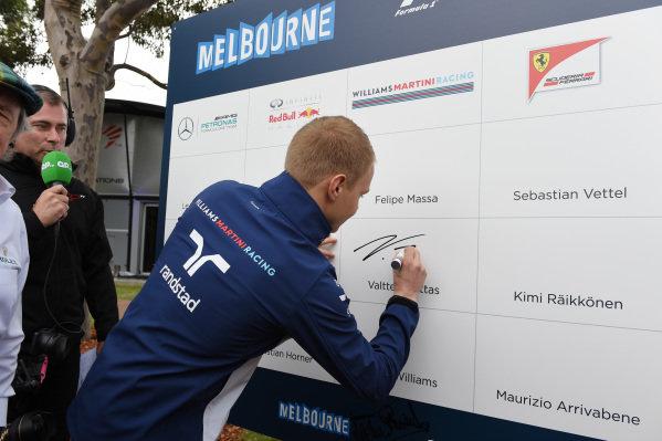 Valtteri Bottas (FIN) Williams signs au autograph at Formula One World Championship, Rd1, Australian Grand Prix, Preparations, Albert Park, Melbourne, Australia, Thursday 12 March 2015.