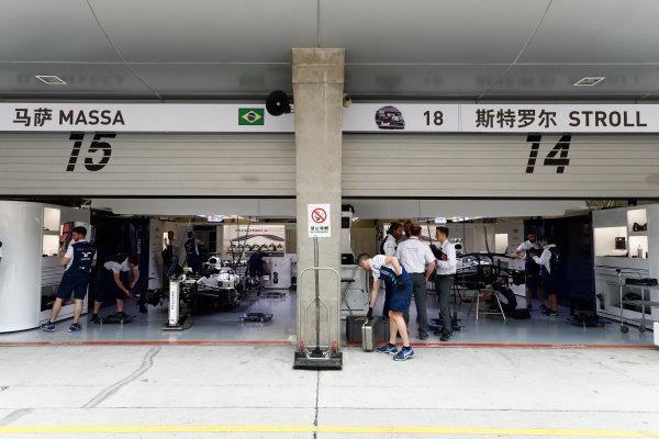 Shanghai International Circuit, Shanghai, China.  Thursday 06 April 2017. The Williams garage containing the Williams FW40 Mercedes cars of Lance Stroll and Felipe Massa. World Copyright: Glenn Dunbar/LAT Images ref: Digital Image _31I3053