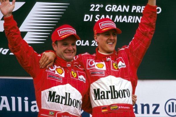 L-R: Rubens Barrichello (BRA) Ferrari, 2nd place, Michael Schumacher (GER) Ferrari, winner San Marino Grand Prix, Imola, Italy, 14  April 2002 BEST IMAGE