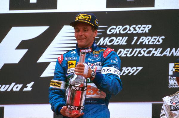 Hockenheim, Germany.25-27 July 1997.Gerhard Berger (Benetton Renault) celebrates 1st position on the podium. His last Grand Prix win.Ref-97 GER 02.World Copyright - LAT Photographic
