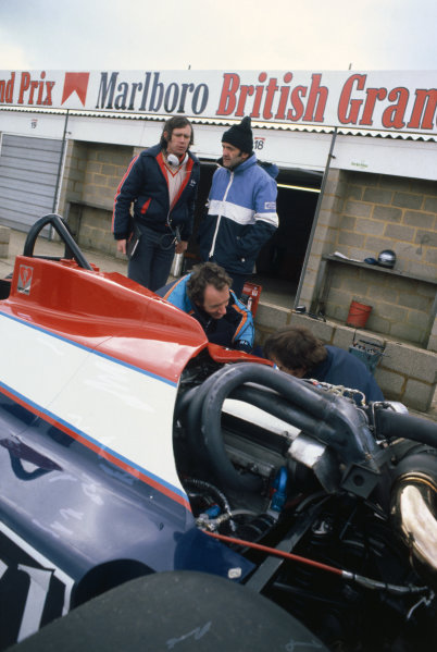 Formula 1 Testing. Silverstone, England. Brian Hart with Rory Byrne look over the Toleman TG181-Hart in the pits, portrait.  World Copyright: LAT Photographic. Ref:  Colour Transparency.
