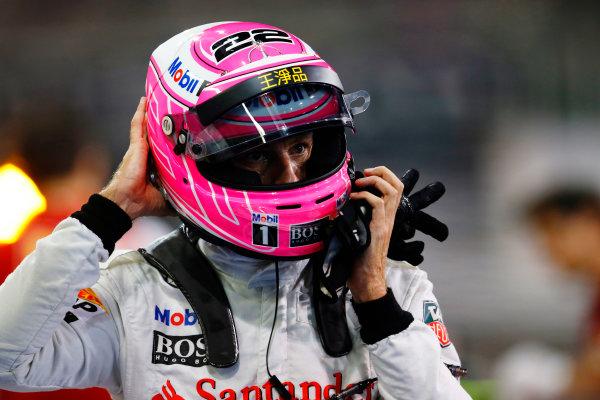 Yas Marina Circuit, Abu Dhabi, United Arab Emirates. Saturday 22 November 2014. Jenson Button, McLaren, arrives in Parc Ferme after Qualifying. World Copyright: Steven Tee/LAT Photographic. ref: Digital Image _X0W0048
