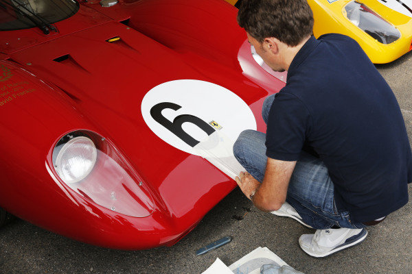 2015 Goodwood Festival of Speed.  Goodwood Estate, West Sussex, England. 25th - 28th June 2015.  Applying race number sticker to 1969 Ferrari 312P.  Ref: KW5_3490a. World copyright: Kevin Wood/LAT Photographic