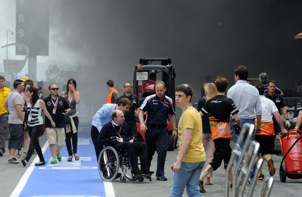 Circuit de Catalunya, Barcelona, Spain 13th May 2012 Sir Frank Williams waits in the pit lane away from the garage fire.  World Copyright: Steve Etherington/LAT Photographic ref: Digital Image ESP-RACE-3521