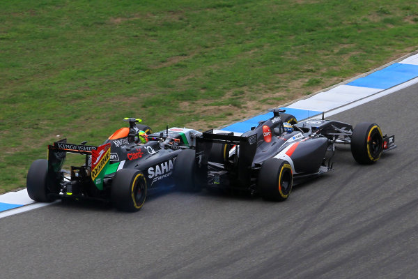 (L to R): Sergio Perez (MEX) Force India VJM07 and Adrian Sutil (GER) Sauber C33 battle. Formula One World Championship, Rd10, German Grand Prix, Race Day, Hockenheim, Germany, Sunday 20 July 2014.   BEST IMAGE