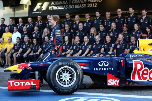 Interlagos, Sao Paulo, Brazil. Thursday 22nd November 2012. Sebastian Vettel, Red Bull Racing, and the 2012 Red Bull Racing team. World Copyright: Andy Hone/LAT Photographic ref: Digital Image HONY0237