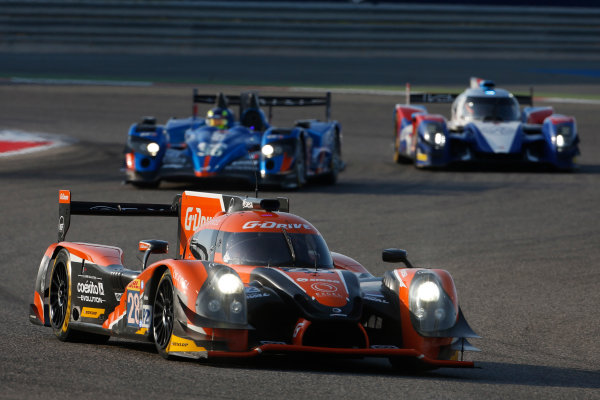 2015 FIA World Endurance Championship Bahrain 6-Hours Bahrain International Circuit, Bahrain Saturday 21 November 2015. Gustavo Yacaman, Luis Felipe Derani, Ricardo Gonzalez (#28 LMP2 G-Drive Racing Ligier JS P2 Nissan) leads Nelson Panciatici, Paul Loup Chatin, Tom Dillmann (#36 LMP2 Signatech Alpine Alpine A450B Nissan) and Mikhail Aleshin, Nicolas Minassian, David Markozov (#44 LMP2 AF Racing BR01 Nissan). World Copyright: Alastair Staley/LAT Photographic ref: Digital Image _79P0187