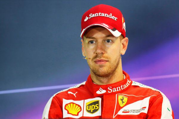 Marina Bay Circuit, Singapore. Saturday 19 September 2015. Pole man Sebastian Vettel, Ferrari, in the post Qualifying Press Conference. World Copyright: Alastair Staley/LAT Photographic ref: Digital Image _79P2349