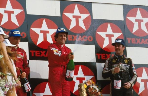 Winner Alain Prost,centre, with second place Niki Lauda, left and third place Nigel Mansell, right.