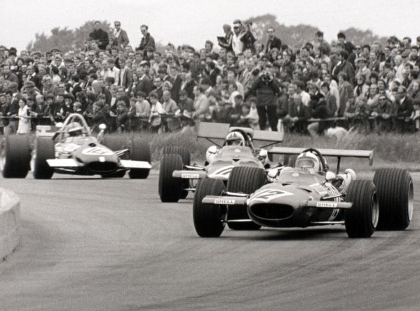 1969 British Grand Prix Silverstone, Great Britain. 19 July 1969 Pedro Rodriguez, Ferrari 312, retired, leads Chris Amon, Ferrari 312, retired, and Piers Courage, Brabham BT26-Ford, 5th position, action World Copyright: LAT PhotographicRef: b&w print