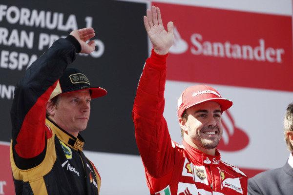 Circuit de Catalunya, Barcelona, Spain 12th May 2013 Kimi Raikkonen, Lotus F1, 2nd position, and Fernando Alonso, Ferrari, 1st position, on the podium. Photo: Andrew Ferraro/LAT Photographic ref: Digital Image _79P6166
