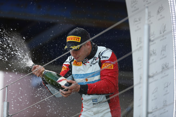 2013 GP3 Series. Round 4.  Nurburgring, Germany.  6th July 2013.  Saturday Race. Facu Regalia (ARG, ART Grand Prix) celebrates his victory on the podium.  World Copyright: Andrew Ferraro/GP2 Series Media Service. Ref: _79P5810
