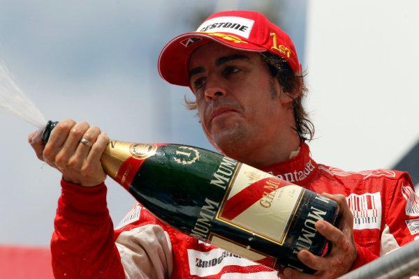 Hockenheimring, Hockenheim, Germany25th July 2010Fernando Alonso, Ferrari F10, 1st position, with his Champagne on the podium. Portrait. Podium. World Copyright: Steven Tee/LAT Photographicref: Digital Image _A8C4509
