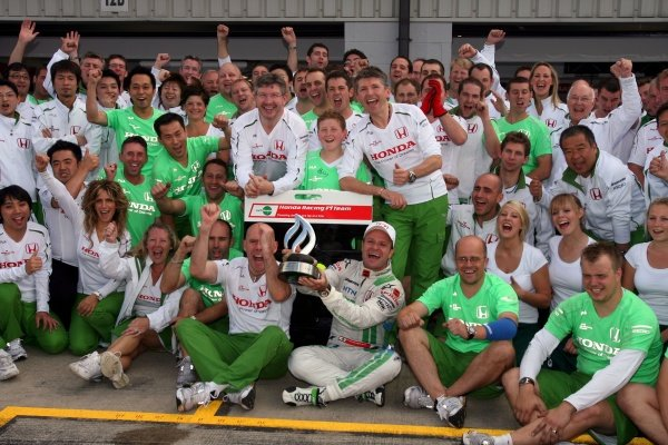 The Honda team celebrate 3rd place for Rubens Barrichello (BRA) Honda Racing F1 Team. Formula One World Championship, Rd 9, British Grand Prix, Race, Silverstone, England, Sunday 6 July 2008.