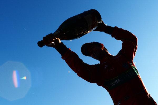 2016/2017 FIA Formula E Championship. Round 11 - Montreal ePrix, Canada Saturday 29 July 2017. WinnerLucas Di Grassi (BRA), ABT Schaeffler Audi Sport, Spark-Abt Sportsline, ABT Schaeffler FE02, sprays the champagne on the podium. Photo: Patrik Lundin/LAT/Formula E ref: Digital Image PL2_0676