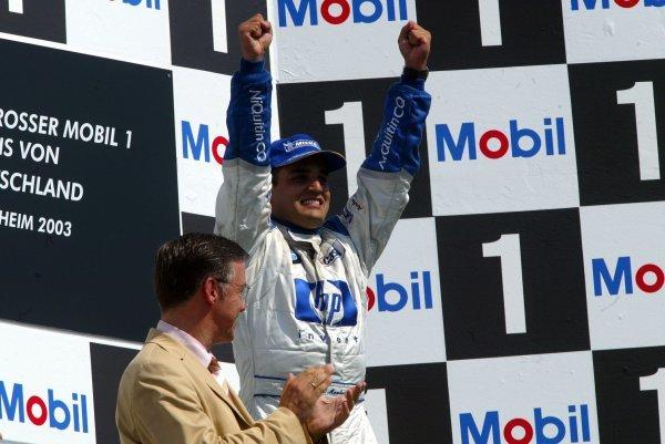 Race winner Juan Pablo Montoya (COL) Williams celebrates on the podium.Formula One World Championship, Rd12, German Grand Prix, Race Day, Hockenheim, Germany, 3 August 2003.DIGITAL IMAGE