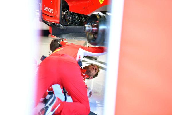 Sebastian Vettel, Ferrari on the garage floor under the Ferrari SF-71H