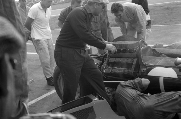 Mechanics work on Jim Clark's Lotus 25 Climax, under direction from Colin Chapman.