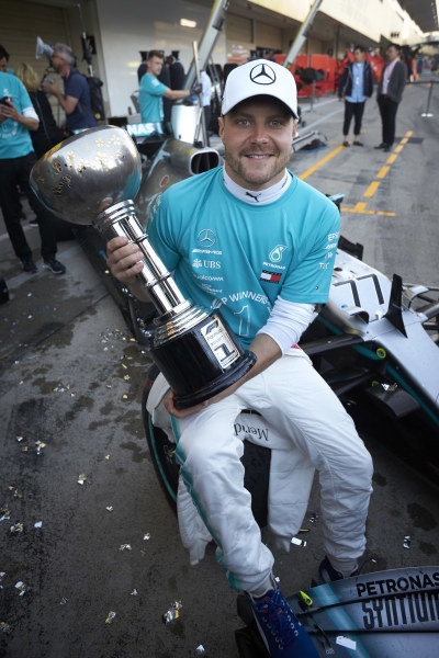 Valtteri Bottas, Mercedes AMG F1, poses with his winner's trophy