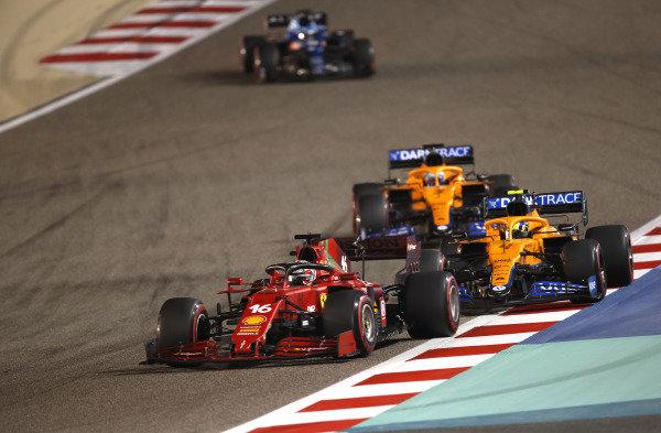 Charles Leclerc, Ferrari SF21, leads Lando Norris, McLaren MCL35M, Daniel Ricciardo, McLaren MCL35M, and Fernando Alonso, Alpine A521