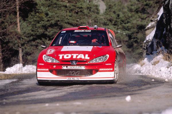 2003 FIA World Rally Championship. Monte Carlo, Monaco. Rd1.23-26 January 2003.Marcus Gronholm/Timo Rautiainen (Peugeot 206 WRC).World Copyright: McKlein/LAT Photographicref: 35mm Image A19