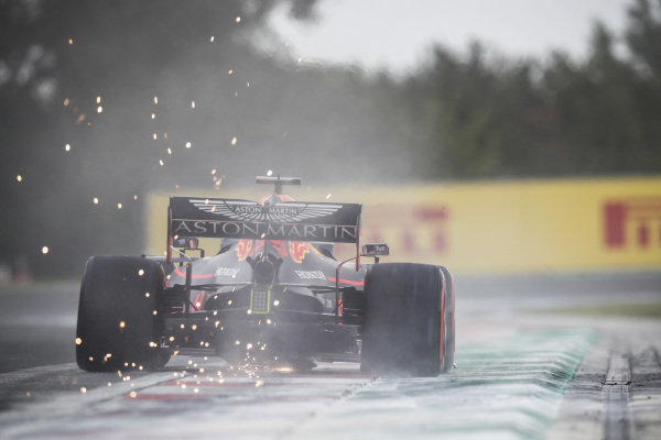 Pierre Gasly, Red Bull Racing RB15, kicks up cement dust