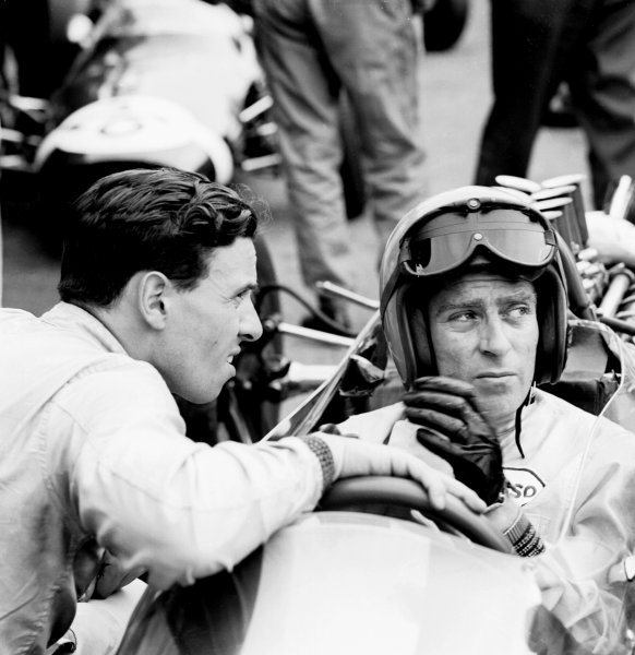 1963 French Grand Prix.Reims, France.28-30 June 1963.Jim Clark has a chat with Peter Arundell (Both Team Lotus). Arundell practiced but did not race in the Grand Prix. He took part in the formula junior race instead.Ref-19821B/W.World Copyright - LAT Photographic