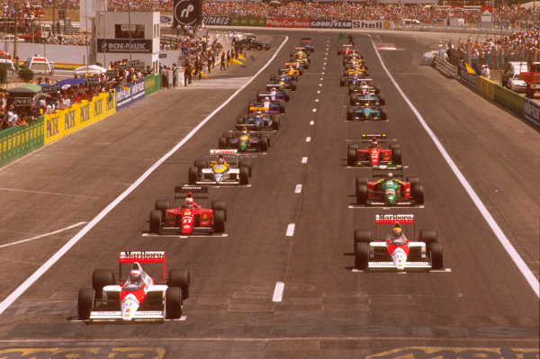Paul Ricard, Le Castellet, France.7-9 July 1989.Alain Prost on pole with teammate Ayrton Senna next to him on the front row (both McLaren MP4/5 Honda's), followed by Nigel Mansell (Ferrari 640), Alessandro Nannini (Benetton B188 Ford) and Thierry Boutsen (Williams FW12C Renault) on the grid at the start.Ref-89 FRA 29.World Copyright - LAT Photographic
