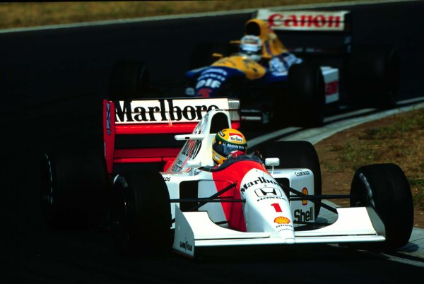 1992 Hungarian Grand Prix.Hungaroring, Budapest, Hungary.14-16 August 1992.Ayrton Senna (McLaren MP4/7A Honda) leads Nigel Mansell (Williams FW14B Renault). They finished in 1st and 2nd positions respectively with Mansell clinching the World Championship.World Copyright - LAT Photographic