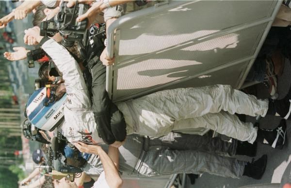 1998 Austrian Grand Prix.A1-Ring, Zeltweg, Austria.24-26 July 1998.Mika Hakkinen (McLaren Mercedes-Benz) celebrates finishing in 1st position with his mechanics.World Copyright - Steve Etherington/LAT Photographic