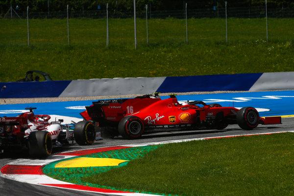Charles Leclerc, Ferrari SF1000, and Sebastian Vettel, Ferrari SF1000 collide on the opening lap