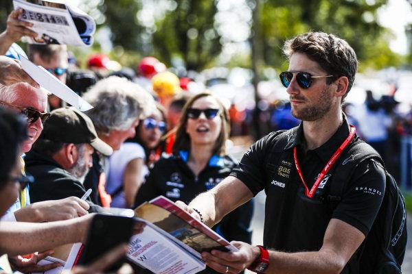 Romain Grosjean, Haas F1 Team signs an autograph for a fan.